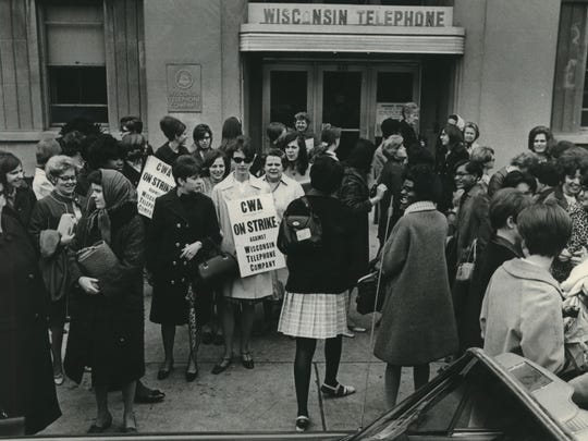 Telephone operators mill around outside Wisconsin Telephone's offices at 845 N. 35th St. on April 18, 1968, shortly after the beginning of a nationwide strike against the Bell Telephone system.