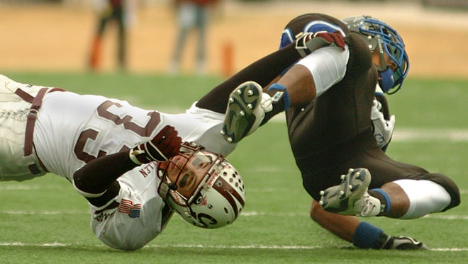 Calallen's Justin Carbajal brings down Lewisville Hebron RB Derk Robinson for a loss during the Class 4A Division II state championship game on Dec. 17, 2005 at Round Rock ISD Stadium.