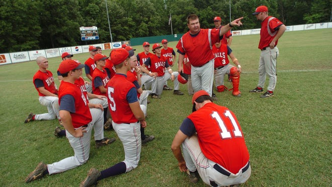Halls baseball coach Doug Polston talks to the team about their advancing to play Farragut for the state championship in 2004.