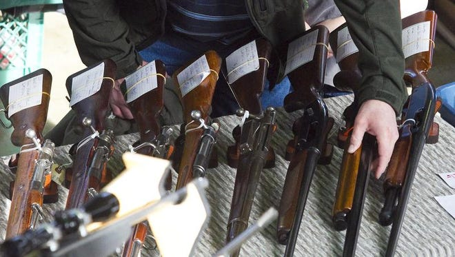 Firearms are displayed at a gun show in Yakima, Wash.