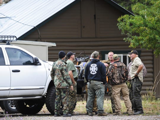 Self-described constitutional rights activists confer in Lincoln. According to retired U.S. Army Sgt. Maj. Joseph Santoro the Oath Keepers and other constitutionalist groups are protecting the rights of the White Hope Mine claimants.