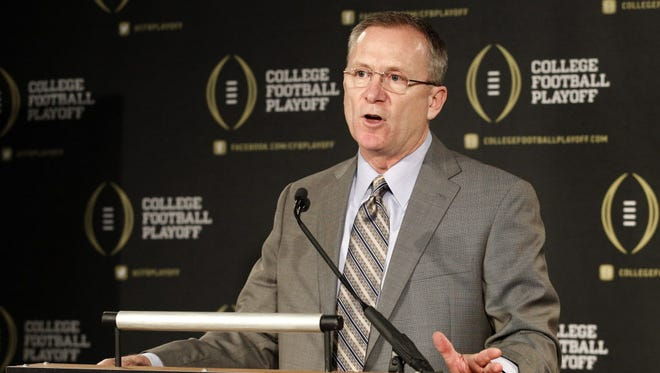 College Football Playoff selection committee chairman and Arkansas athletic director Jeff Long responds to questions during a news conference.