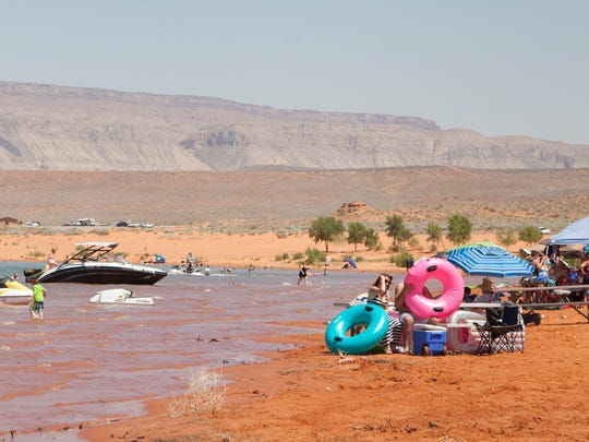 St. George residents gather for the Boardfest at Sand Hollow Reservoir for a weekend of watersports, ATVs and music Saturday, June 20, 2015.