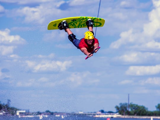 Newt Kitchens flies high competing in the expert division of the Wake the Desert compeition July 22, 2017, in Lake Nasworthy.