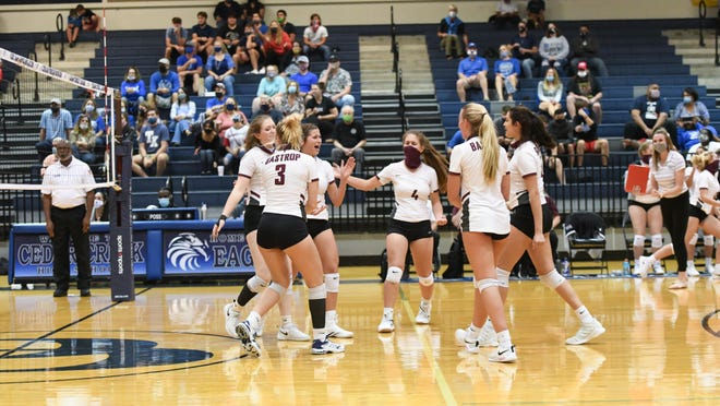 Bastrop players celebrate a point.