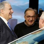 (L to R) NHTSA administrator Mark R. Rosekind, Sergio Marchionne, CEO of FCA and Earl Weener, a board member with NHTSA, have a laugh during their brief meeting at the FCA stage at the 2016 North American International Auto Show in Detroit. Eric Seals/Detroit Free Press