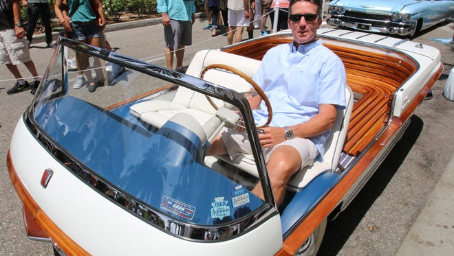 Bill Cord sits in his 1956 Fiat Eden Roc at the Rodeo Drive Concours d'Elegance in Beverly Hills.