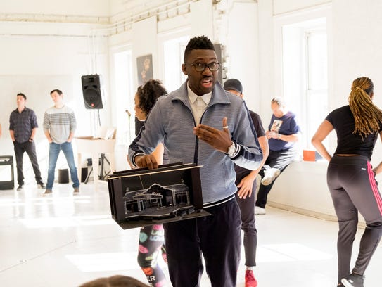 """Director Kwame Kwei-Armah holds a model of the stage for the new theatrical production """"SOUL The Stax Musical,"""" which opens at the Baltimore Center Stage theater in May 2018. The production traces the history of Stax Records, which was founded in Memphis, Tenn."""