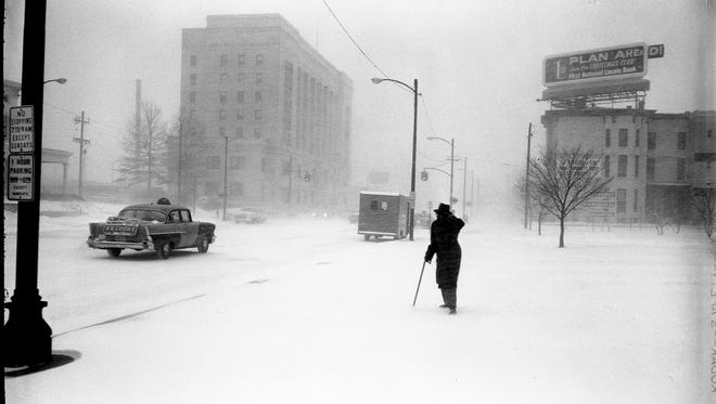 A man makes his way along East Broadway in Louisville during a late January snow storm. Jan. 23, 1963