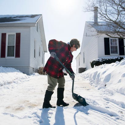Linda Briody clears off her North Side Evansville driveway