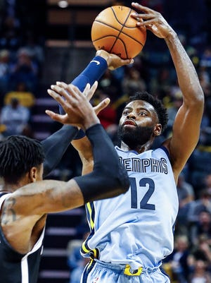 Memphis Grizzlies guard Tyreke Evans (right) hits a three-pointer against the Brooklyn Nets defense during second quarter action at the FedExForum in Memphis, Tenn., Sunday, November 26, 2017.