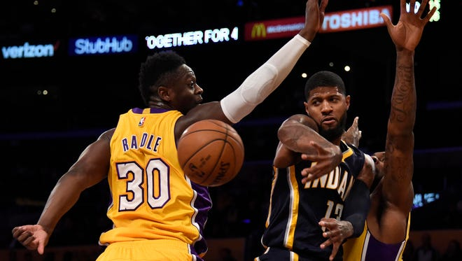Jan 20, 2017;  Los Angeles, CA, USA; Indiana Pacers forward Paul George (13) passes the ball against Los Angeles Lakers forward Julius Randle (30) at Staples Center. Mandatory Credit: Richard Mackson-USA TODAY Sports