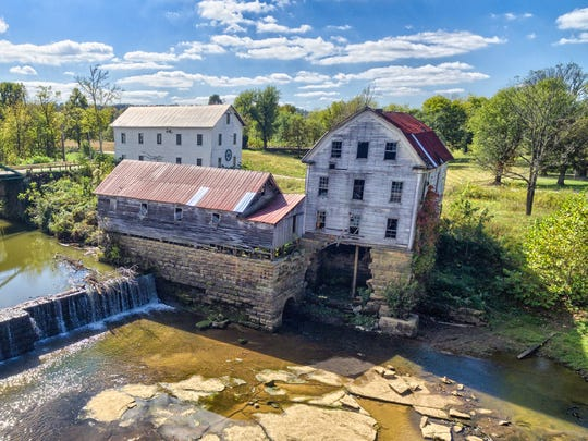 An overhead view from 2015 shows the mill buildings at Falls of Rough before a corner of the grist mill, at right, fell into the river. A rush to restore the once-thriving but rapidly deteriorating village is underway.