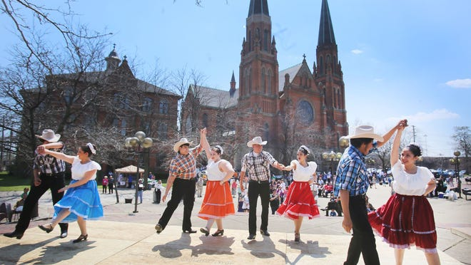 """Following the Detroit Mass Mob at Ste. Anne's Church in Detroit, a dance group from the church """"Ballet Folklorico de Los Renacidos"""" perform for their guests in the church courtyard Sunday, May 3, 2015."""