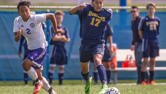 Battle Creek Central's Cesar Duran (no. 17) advances the ball while Lakeview's Lal Lian follows (no.2) during the All City Soccer finals on Saturday.