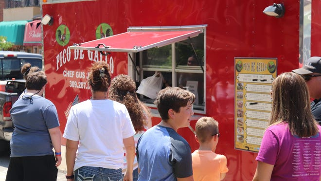 People took advantage of the Pico De Gallo food truck parked in front of the Historic Livingston County Courthouse on Mill Street to grab some lunch Wednesday afternoon.