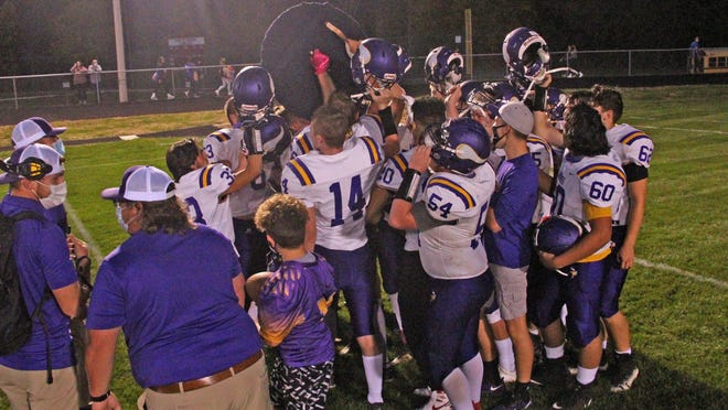 The Bronson Vikings celebrate with The Shield after defeating Union City 24-6 Friday.