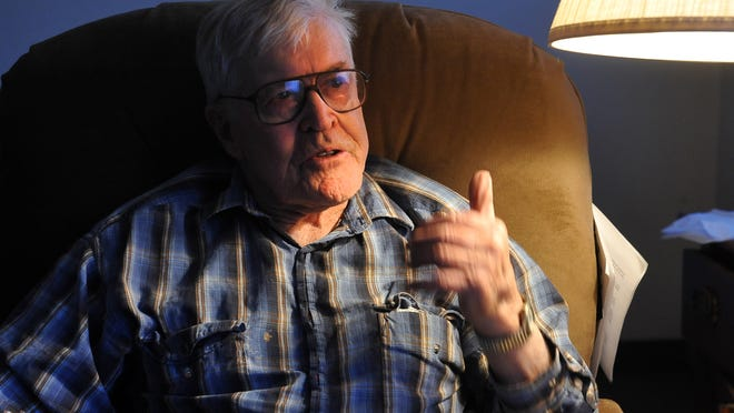 World War II veteran Keith Ginther talks about his time in German POW camp on December 8, 2011, from his room at the Skyline Lodge in Choteau.