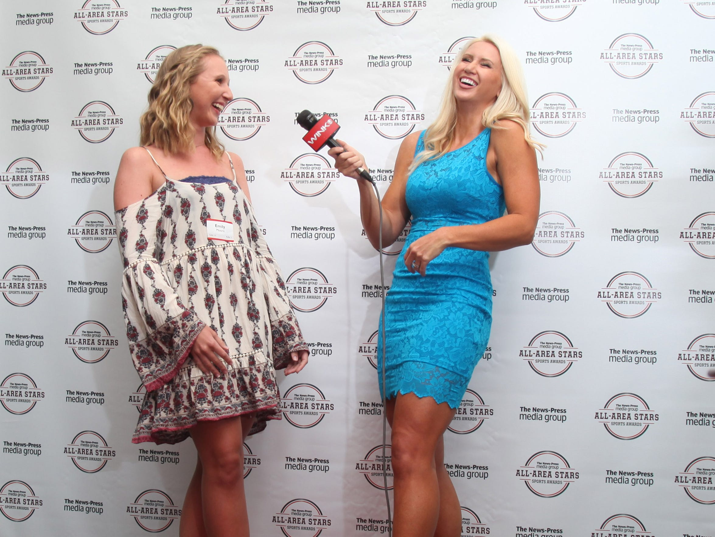 Emily Moore, of Evangelical Christian School, shares a laugh with Chelsa Messinger, of WINK Sports, during an interview on the red carpet at the All-Area All Stars Banquet at Germain Arena on Tuesday night.