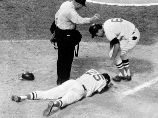 FILE - In this Aug. 18, 1967, file photo, Boston Red Sox outfielder Tony Conigliaro writhes in pain on the ground after being beaned by Jack Hamilton of the California Angels in the fourth inning of a baseball game at Fenway Park in Boston. Teammate Rico Petrocelli (6) comes to Conigliaro's aid as home plate umpire Bill Valentine calls time out. Hamilton, whose errant inside pitch damaged the eyesight of Conigliaro and caused a premature end to the career of the Red Sox star, has died. He was 79. Hamilton died Thursday, Feb. 22, 2018, at the Shepherd of The Hills Living Center in Branson, Mo., the Greenlawn Funeral Home said. (AP Photo/Bill Chaplis, File)