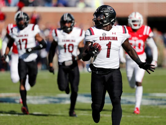 South Carolina wide receiver Deebo Samuel (1) looks around to make sure no Mississippi defender is near on his way to a 90-yard kickoff return for a touchdown during the first half of an NCAA college football game, Saturday, Nov. 3, 2018, in Oxford, Miss. (AP Photo/Rogelio V. Solis)