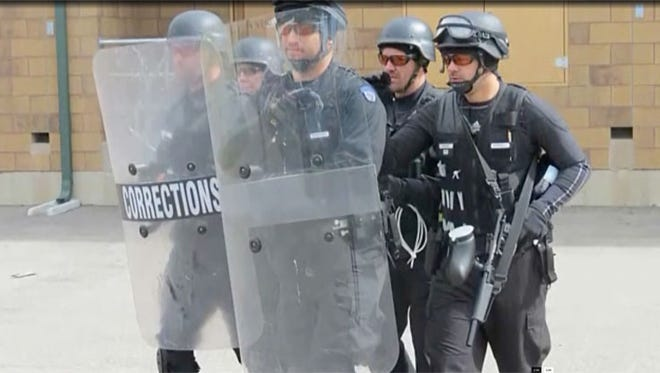 A Wisconsin Department of Corrections video depicts officers in riot gear.