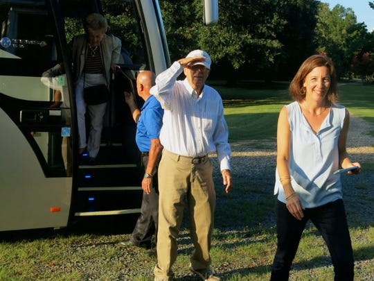 John Guth and Mary Guth Ratcliff  lead the way from the chartered bus to the Jeems Bayou for the anniversary dinner.