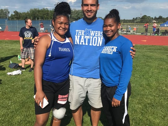 Teaneck discus throwers: (from left) Jessica Thompson, assistant coach Chris Infante and Jade Young.