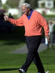 Golf legend Arnold Palmer gives thumbs up at the Bob Hope Chrysler Classic at Bermuda Dunes Country Club.