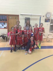 Raritan Bay Catholic Prep's Sacred Heart Grades 3 & 4 Girls Basketball Team won the championship game and took first place in the Central Jersey Basketball League. The team from South Amboy defeated Monroe by a score of 19-6 on March 15 to clinch the championship. The team members pictured are, from left to right, Gabriela Mieczkowski, Ashley Ament, Madison Freudenberg, MaryKate Brew, Kamryn Miller, Haley Higgins, Erin McCabe and Ashley Solfilkanich. The team is coached by Judy McCabe and Deirdre Resch.