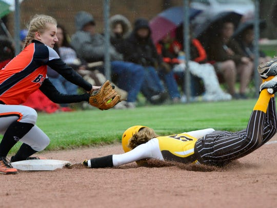 Old Fort's Ashtyn Sebetto slides into third as Gibsonburg's Emily Roberts takes a throw.
