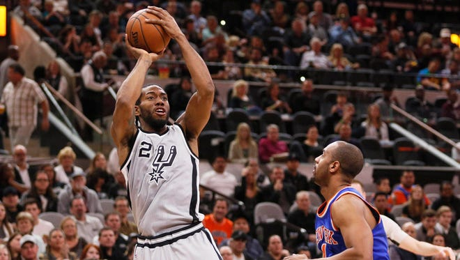 San Antonio Spurs small forward Kawhi Leonard (2) shoots the ball over New York Knicks shooting guard Arron Afflalo (right) during the first half at AT&T Center.