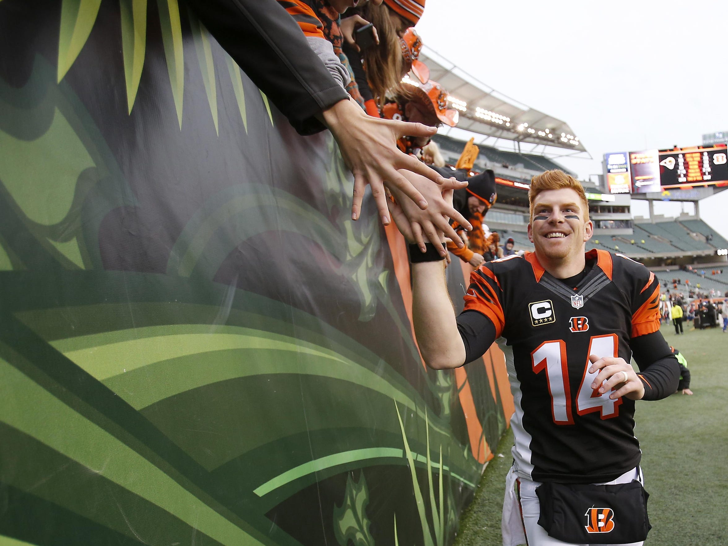Andy Dalton high-fives fans after a 31-7 victory over