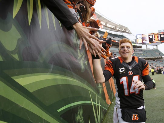 Andy Dalton high-fives fans after a 31-7 victory over the St. Louis Rams on Nov. 29, 2015 at Paul Brown Stadium.