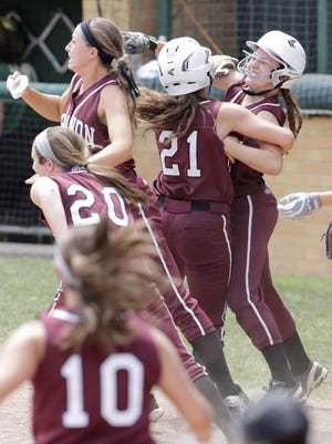 Lebanon's Chloe Allen, center, is mobbed by teammates after scoring the winning run in the bottom of the seventh inning.