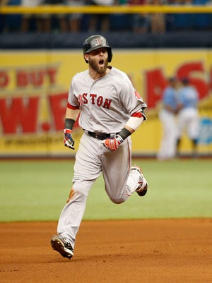 Boston Red Sox second baseman Dustin Pedroia (15) celebrates as he runs around the bases as he hits a 2-run home run seventh inning against the Tampa Bay Rays at Tropicana Field.