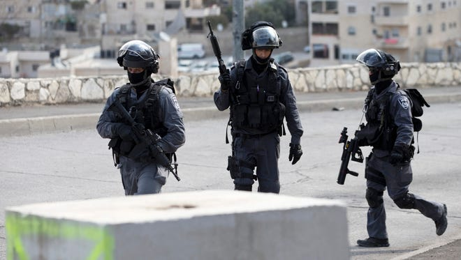 Israeli riot police officers Oct. 20, 2015, operate in the Arab neighborhood of Issawiyeh in Jerusalem.
