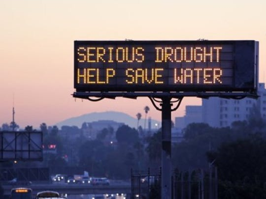 Highway sign urges Californians to save water.