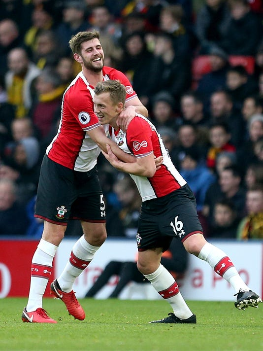 Southampton's James Ward-Prowse, right, celebrates scoring his side's first goal of the game with teammate Jack Stephens during the English Premier League soccer match against Watford at Vicarage Road, Watford, England, Saturday Jan. 13, 2018. (Steven Paston/PA via AP)