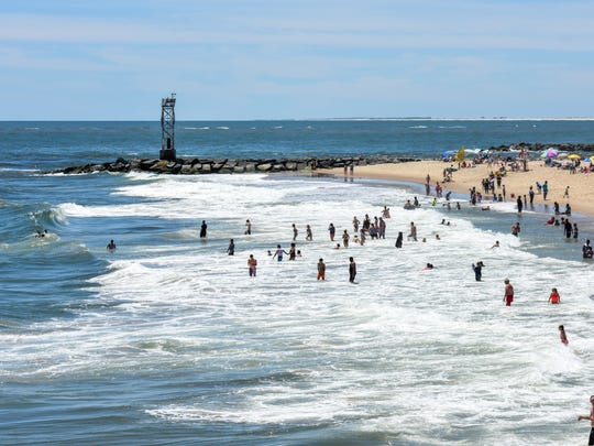 The Ocean City beach was crowded with kids and adults playing in the waves on Monday.