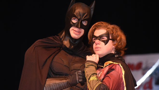 Nikolai Filipek a take the role of Batman as Brody Tolliver portrays Robin during Caddo Magnet High's performance of A Mid-Summer Night in Gotham City.