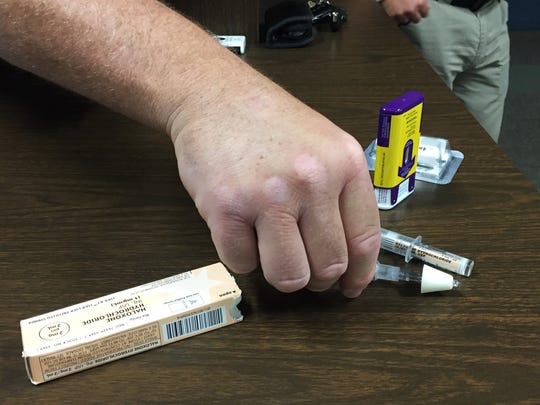 Buncombe County sheriff's deputies prepare a Narcan kit as part of training school resource officers Wednesday, Sept. 6.
