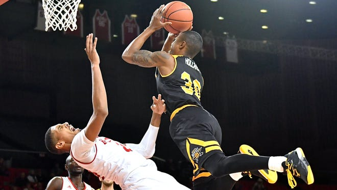 NKU's Lavone Holland II throws up a shot over a Miami defender Sunday. A blocking foul was called on the play.