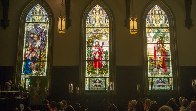 A crowd gathers in the sanctuary of St. John's Lutheran Church on 544 N. Broadway before a service, held in response to the Orlando massacre and other recent shootings, on Tuesday, July 12, 2016. (CAITIE MCMEKIN / NEWS SENTINEL)
