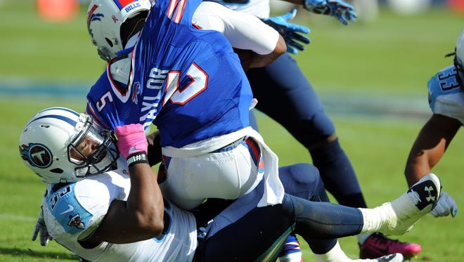 Bills quarterback Tyrod Taylor (5) is tackled from behind by Titans linebacker Zach Brown (55) on Sunday.