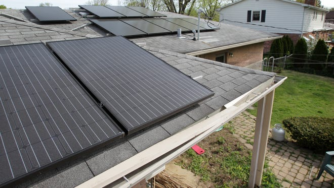 "Rabbi Bruce Pfeffer and his wife Dr. Amy Beth Kressel have 32 solar panels installed on the roof of their home in the 500 block of Holliday Lane in Indianapolis, shown on Thursday, March 29, 2012. Since they are on the back of the house, most cannot be seen from the street. The panels are able to produce about 30 kilowatt hours of solar power each day and use it for their home and a hybrid car. There has been a huge increase in ""net metering"" in Indiana, where utilities customers with solar panels are able to generate more electricity than they use and get a credit on their bills."