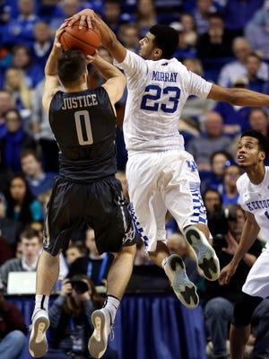 Kentucky guard Jamal Murray (23) blocks the shot of Vanderbilt guard Camron Justice (0) in the second half of the Wildcats' 76-55 win on Jan. 23, 2016.