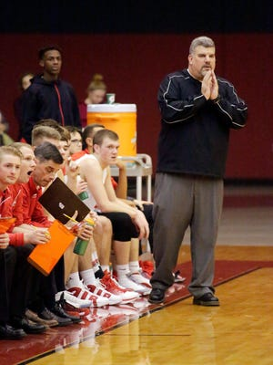 Sheboygan South coach Mike Rank watches from the bench Tuesday November 29, 2016 at South.