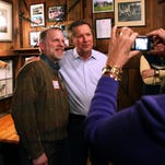 Gov. John Kasich's supporters are fundraising for a possible 2016 presidential bid. Here, Kasich poses with a GOP voter on a campaign stop in New Hampshire.