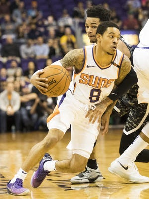 Phoenix Suns guard Tyler Ulis (8) uses a pick to get around San Antonio Spurs guard Dejounte Murray (5) during the first quarter at Talking Stick Resort Arena in Phoenix, Ariz. February 7, 2018.